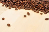 Coffee on grunge wooden background — Stock Photo