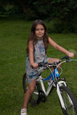 Eight years old girl on the bike — Stock Photo