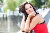 Smiling woman in a bridge — Stock Photo