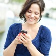 Young woman writing on a phone — Stock Photo