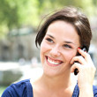 Young woman smiling on the phone — Stock Photo #12843184