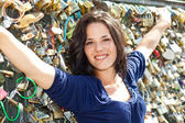 Nice woman and padlocks of love — Stock Photo