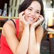 Smiling young woman on terrace — Stock Photo #12873652