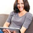Smile and modern technology — Stock Photo