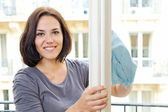 Woman cleaning windowpane — Stock Photo