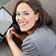 Stock Photo: Cute brunette and electronic tablet