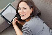 Cute brunette and electronic tablet — Stock Photo