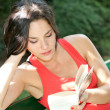 Woman reading in a park — Stock Photo #14284115