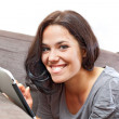 Cute smile and electronic tablet — Stock Photo