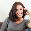 Young woman on the phone — Stock Photo #14286073