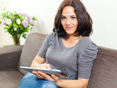 Smiling woman and touchpad — Stock Photo