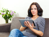 Woman using a touchpad — Stock Photo