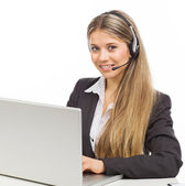 Smiling phone operator with laptop — Stock Photo