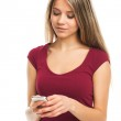 Young woman writing on her smartphone — Stock Photo