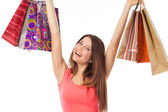 Cheerful young woman with shopping bags — Stock Photo