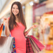 Smiling girl in a shopping center — Stockfoto
