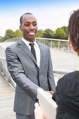 Business collaborators handshaking — Stock Photo