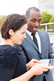 Businesspeople working outdoors — Stock Photo