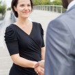Businesspeople handshaking — Stok fotoğraf