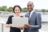 Businesspeople on laptop — Stock Photo