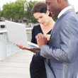 Businesspeople on laptop, outdoors — Stock Photo