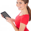 Stock Photo: Young womusing electronic tablet