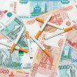 Royalty-Free Stock Photo: Cigarettes and rubles. Expensive habits.