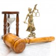 Statue of justice, gavel, law book and hourglass — Stock Photo