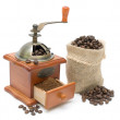 Coffee grinder and coffee beans on a white background — Stock Photo