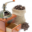 Coffee beans and coffee grinder on white background — Stockfoto