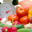 Kitchen scale and vegetables — Stock Photo #13815997