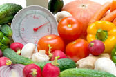 Kitchen scale and vegetables — Stock Photo