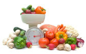 Vegetables and kitchen scales isolated on white background — Stock Photo