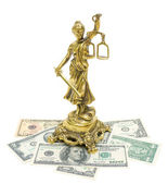 Statue of justice and money isolated on white background — Stock Photo