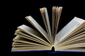 Book on a black background - close-up — Zdjęcie stockowe