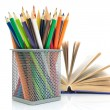 Colored pencils and a book on a white background — Foto Stock