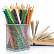 Colored pencils and a book on a white background — Stock Photo
