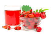 Rose hips, hawthorn and drink on a white background — Stock Photo