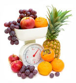 Scale and fruits isolated on white background — Stock Photo