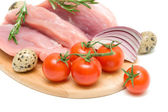 Cherry tomatoes, raw meat, eggs, onions and a sprig of rosemary — Stock Photo