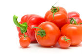 Fresh vegetables - tomatoes and peppers on a white background — Stock Photo