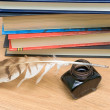 Stock Photo: Pen, ink and books on wooden board