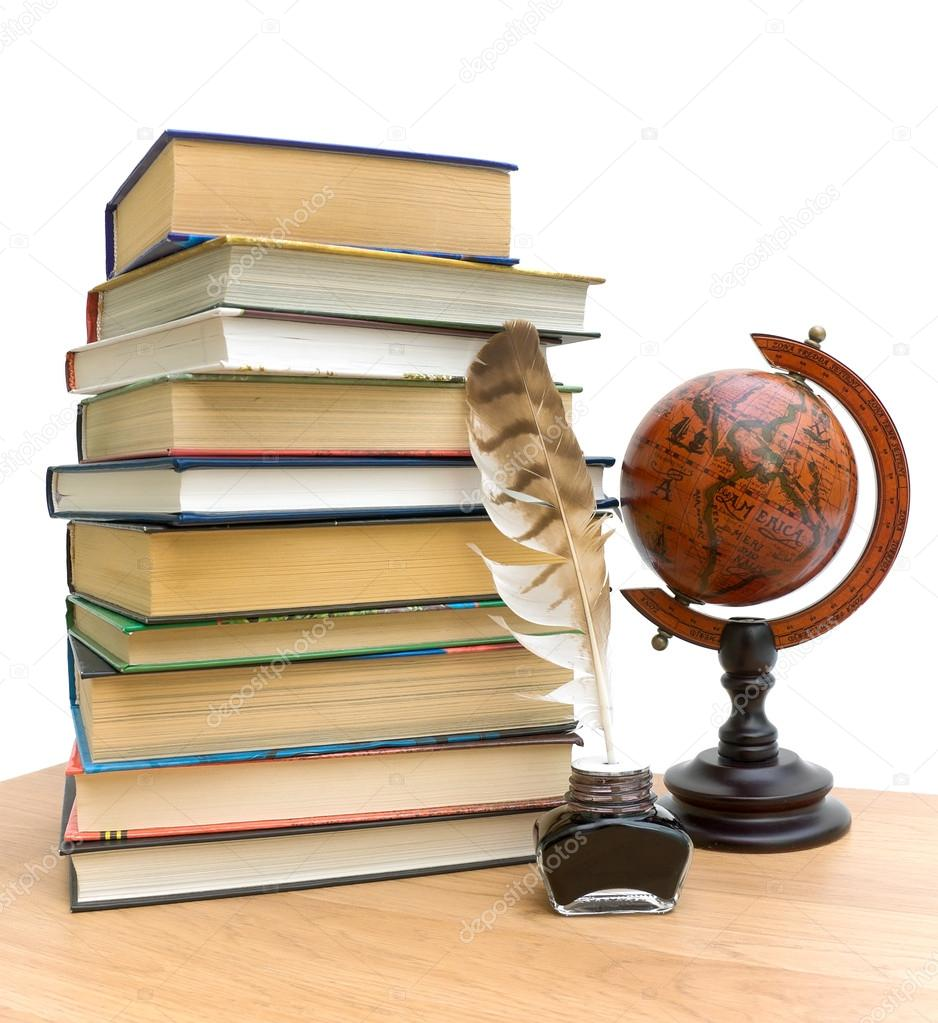 Stack of various books, pen in the ink and vintage globe on white background — Stock Photo #18591661