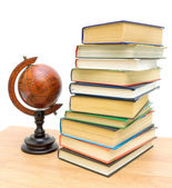 Antique globe and a stack of different books — Stock Photo