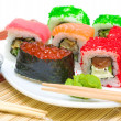Traditional Japanese food. Different sushi rolls, wasabi and pic — Stock Photo #18806219