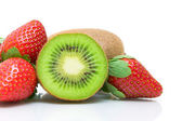 Half kiwi and strawberries close-up on white background — Stock Photo