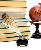 Inkstand, pen, books and a globe on a white background — Stock Photo