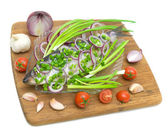 Herring, cherry tomatoes, garlic and onions on a white backgroun — Stock Photo