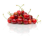 Ripe cherry on a white background with reflection — Stock Photo