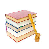 Gavel and five books isolated on white close-up — Stock Photo